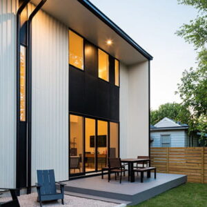 E-Series gliding patio doors picture windows with black exteriors  Modern home style Raleigh, North Carolina (NC)  Builder:  Architect: The Raleigh Architecture Company   Keywords: urban, dusk, glow, metal, blue sky, patio, indoor/outdoor, contrast