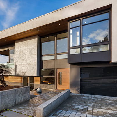 E-Series casement, awning, picture and transom windows; Black exterior, painted White interior; White folding hardware; frosted glass in awning windows  Kirkland, Washington (WA)  Builder: Taylor Building & Design, LLC, Kirkland, WA Architect: Phil McCullough Architects    Keywords: concrete, angles